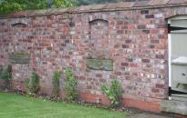 Garden wall built from reclaimed bricks
